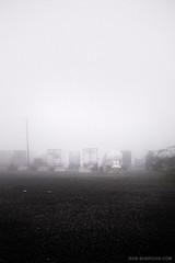 North Carolina Truck Stop. 6.11.09, 6:30am. (Rob Sheridan) Tags: fog eerie gasstation truckstop trucks robsheridan