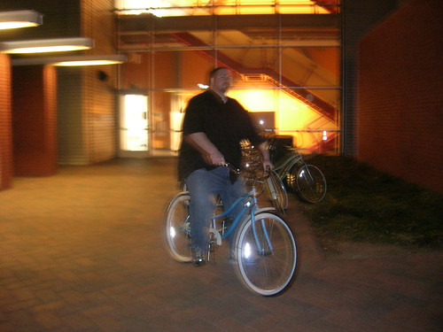 Andrew Melchior cruising the Google campus on a custom Google beach cruiser.