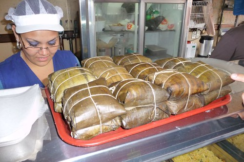 Tamales, a typical Latin American corn dish wrapped in banana leafes...