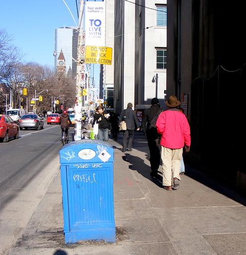 Blue garbage bin