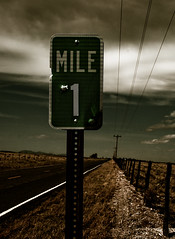 i would walk 500 miles ({carole}) Tags: road crossprocessed wildwest bullethole highway41 top20nm explore214 mile1 mountainairnm