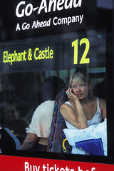 London's commuter call © Rob Watkins 2008 (Aland Rob) Tags: from street travel summer england people woman elephant bus cute london castle window mobile work shopping bag out pretty sitting phone looking dress traffic telephone working picture going daily photograph sit stare 12 sat moment talking staring windscreen seated carrier