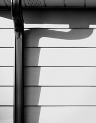 Downspout (JeffStewartPhotos) Tags: shadow blackandwhite bw home blackwhite shadows siding downspout downspouts flickrgolfclub