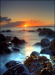 Sunset over Arisaig (angus clyne) Tags: longexposure sunset sea seaweed skye beach clouds scotland spring rocks waves stones rum redsky loch westcoast rhum arisaig eigg flikcr glenuig lochailort flickrsbest smallisles soundofarisaig colorphotoaward obramaestra