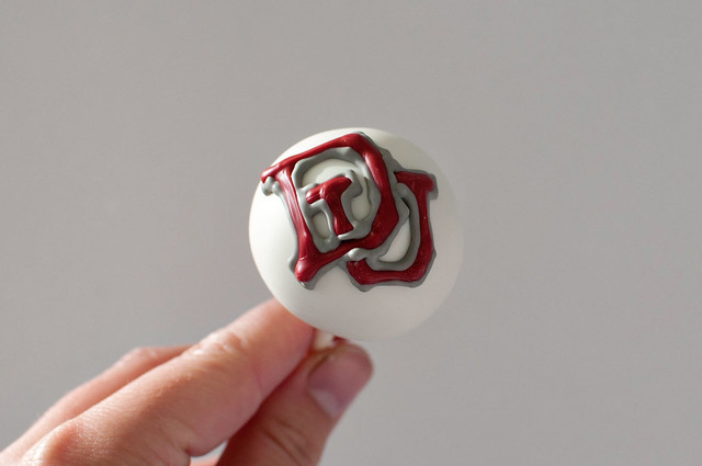 Denver University logo groom cake pops