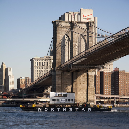 The Venturi house floats past the Brooklyn Bridge. (All photos by Douglas Romines)