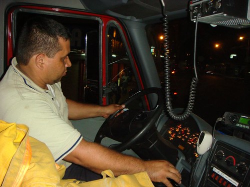 Enrique, the fire fighter from Palmar Norte, Costa Rica, giving me a spin around the block in the massive machine...