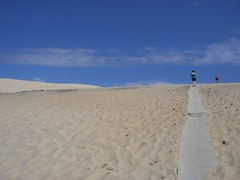 Hiking the Great Dune of Pyla (traveling peter) Tags: blue sky france beach clouds walking outdoors sand beige europe hiking path dune august bluesky hiker 2008 bassin pyla aquitaine arachon gironde latestedebuch lebassin girondedepartment duneofpyla aquitaineregion year2008 ladunedupilat bassindarachon thegreatduneofpyla arachonbay