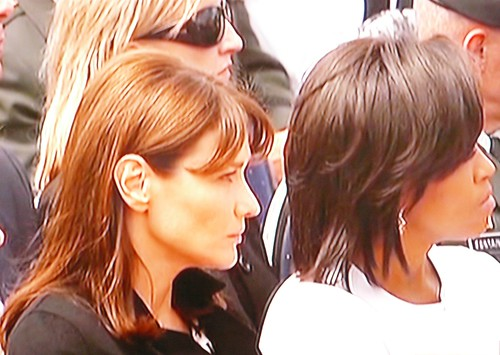 Carla Bruni Sarkozy and Michelle LaVaughn Obama during the 65th anniversary of the D-Day landings on France's Normandy beaches