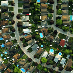 Welcome to Suburbia (stephanie.keating) Tags: blue trees houses urban green backyard suburban suburbia aerialview aerial roads swimmingpools savedbythedeletemeuncensoredgroup fave5 fave10 fave25 housesfromabove s10d5