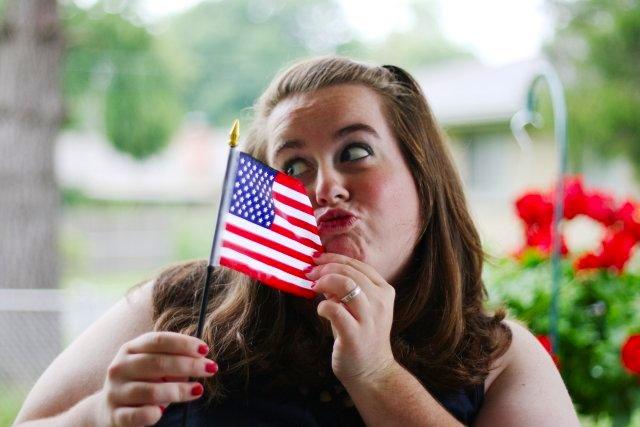 kristen kissing the flag