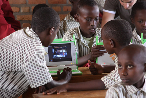 Kagugu teacher Simon's students using XOs for outdoor language learning