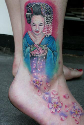geisha with cherry blossom flowers tattoo by MIrek vel Stotker