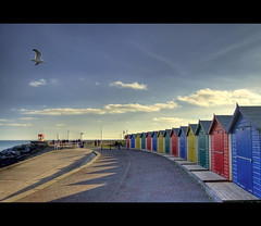 ..: Beach Huts :.. (Komatoes) Tags: uk blue red sea sun beach water yellow clouds photography photo nikon shadows seagull picture huts explore devon photograph warren launch nikkor 13 fp frontpage beachhuts hdr slipway dawlish lifeguardhut d40 n