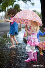 Playing in the Rain Puddles (a.d.miller) Tags: road park street girls playing water girl rain kids umbrella canon children puddle child play florida wellies galoshes pensacola 50mmf14 spalsh splashing rainboots sevillesquare rainpuddle 40d