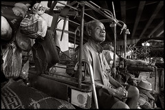 The man and the Tuk tuk (fly) Tags: man thailand asia bangkok homeless rail tuktuk earthasia fly simonkolton