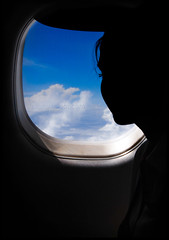 Window to the world (Yug_and_her) Tags: blue sky woman india travelling eye window glass girl silhouette clouds hair flying nikon lashes profile flight archive dreams hopes reality hyderabad airlines paramount coimbatore windowseat airhostess lookingthroughthewindow d80 conceptphotos
