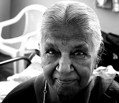 Older women are like aging strudels - the crust may not be so lovely, but the filling has come at last into its own. (legends2k) Tags: old portrait blackandwhite woman monochrome smile face lady lumix grandmother panasonic g1 aged granny aging wrinkles fourthirds aaya chettinad pillayarpatti microfourthirds panasonicdmcg1 robertfarrarcapon