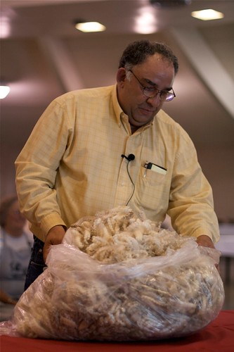 Mark Eidman judging a fleece