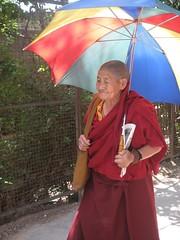 Monk wih a colorful Umbrella (travelholic.himalayas) Tags: india tibetans ceremony monks wishes exile himalayas dalailama dharamshala dharamsala mcleodganj himachalpradesh traditonal northernindia karmapalama tibetanboy kangravalley tibetanexile dalailamabirthday74