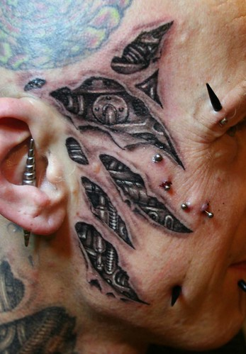 biomechanic face tattoo by Mirek vel Stotker
