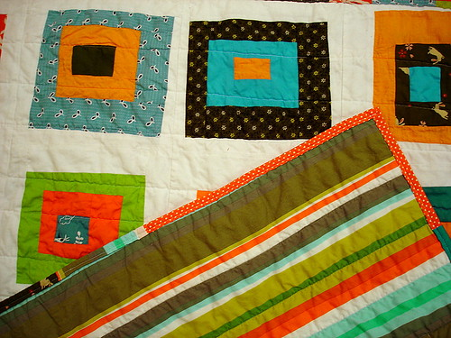 back detail of baby quilt - orange, teal, lime green, pine green