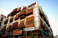 Crumbling History (Shabbir Siraj) Tags: street wood windows building heritage window architecture wooden nikon day apartment market text middleeast plaster historic wires saudi arabia shops april historical lime arabian jeddah balad tamron 2009 roshan streetshot ksa hejazi  historicarea   coralstone hijazi  d40  albalad  18270 roushan  roshaan oldjeddah rawshaan