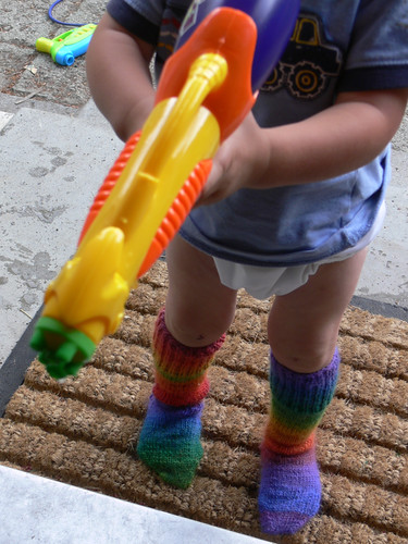 Water-gun and woolen socks