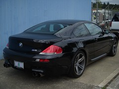 2009 BMW M6, 19 inch rims (SoulRider.222) Tags: black reflection afternoon chrome bmw mspaint ps2 m6 michelin 250 v10 6series bmwm6 blackcar whileriding 50l vanos michelintires 7speed pilotsport2 nikoncoolpixs50 19inchrims michelinpilotsport2 40valves 50lv10 205mph 19inchwheels 40valve michelinps2 2009bmw them6hasapowerbuttonthatmodifiesthethrottleresponsefromignitionthecardelivers399hpbutengagingthebuttonallowsafull500hp s85b50engine 50lv10507hp7750rpm384lbfttorque6100rpm 7speedsmgiiigearbox mahlemotorsport mahlemotorsportoilcooledforgedaluminumpistons vanostimingvalves doublevanostimingvalves carbonfiberreinforcedplasticroofpanel bmws85b50dohc40valvev10 s85b50 40valvev10 michelinpilotsport2tires 2009bmwm6 2009m6 19x950 28535r1999z 28535r19 19x95028535r1999z 19x95028535r19