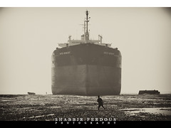 Bangladesh Ship breaking Yard : Iron Giant (Shabbir Ferdous) Tags: people monochrome photographer shot bangladesh oiltanker chittagong bangladeshi ef70200mmf28lisusm shipbreakingyard canoneos5dmarkii shabbirferdous wwwshabbirferdouscom shabbirferdouscom