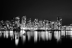 (Jordan Chark) Tags: city urban blackandwhite bw canada reflection skyline vancouver buildings boats lights downtown bc view britishcolumbia falsecreek granvilleisland february 2009 30secexposure