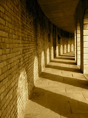 Doorways to the Imagination (Nicolle Carter) Tags: light shadow brick cemetery sepia doors stones flag dreams imagination curve darkversuslight