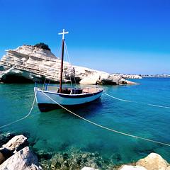 Moored boat (iOpeners UK) Tags: blue white fish water pull boat fishing rocks europe cross religion fast calm greece string corfu hold sidari