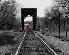 Walking the Tracks (**Ms Judi**) Tags: bridge trees sky blackandwhite tree beautiful wisconsin wonderful walking vanishingpoint interesting midwest branches tracks teens ground adventure explore teen journey peshtigo trainbridge dreamers countrylife spotcolor walktheline selectivecoloring explored msjudi walkingthetracks peshtigowisconsin judistevenson walkthelinebyjohnnycash