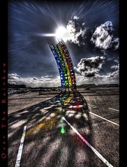 Over the Rainbow (Ptur Gunn Photograpphy) Tags: blue red sky sun green art colors yellow photo iceland airport rainbow artwork parkinglot angle 10 sony parking contest wide over sigma super winner alfa 20 700 1020 hdr sland petur gunn sunflare ptur gunnarsson regnbogi keflavk golddragon abigfave platinumphoto