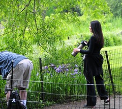 Bum photographer? (nikkorglass) Tags: nyc newyorkcity flowers woman usa newyork man ass