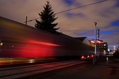 Twilight Train (Jon Asay ) Tags: railroad blur night oregon train portland movement twilight long exposure industrial dusk district central tracks eastside
