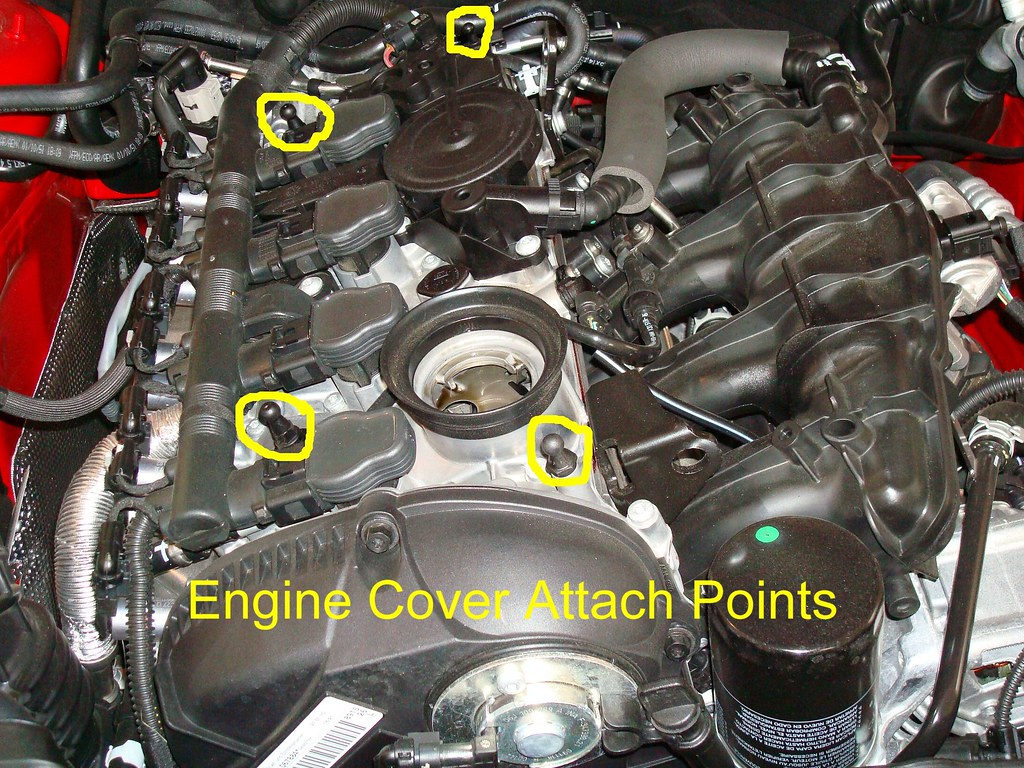 Position a shop towel around the base of the oil filter to absorb any residual oil that may drip out as filter is removed