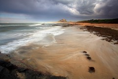 Distant Bamburgh (midlander1231) Tags: longexposure sea england sky seascape beach nature clouds landscape coast britain northumberland shore northumbria bamburgh farneislands bamburghcastle shorelinn
