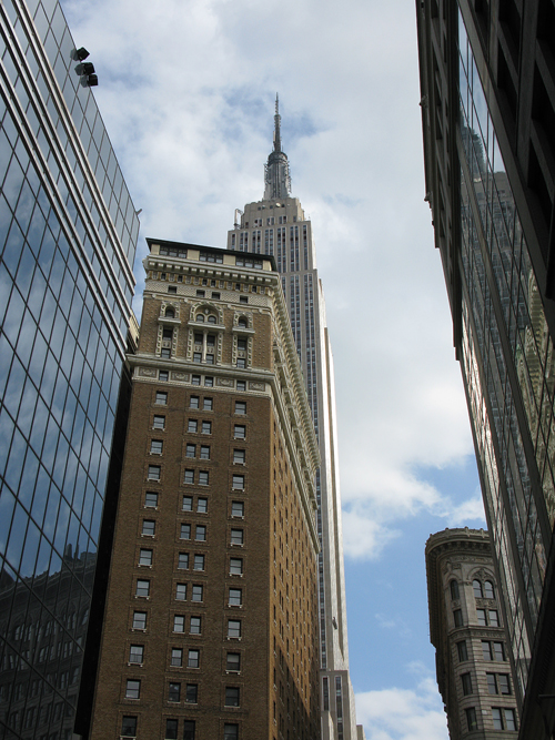 a view from 33rd Street in Manhattan includes the Empire State Building, NYC