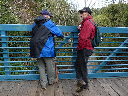 Jim and Larry stop on the bridge.