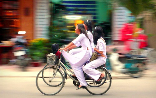 schoolgirls on bikes