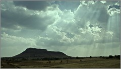 Beautiful side of somewhere.. (flickrohit) Tags: india rain clouds trek fort maharashtra sunrays rohit rohitgowaikar bhushangad