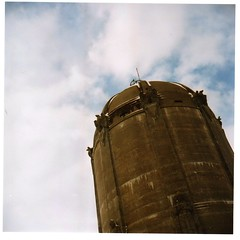The Washburn Watertower in Tangletown (A2ZMpls) Tags: camera wild sky sculpture tower 120 film water analog mediumformat jones lomo lomography eagle kodak russia watertower 120format cement picture harry minneapolis scan 120film health 400 soviet lubitel medium format analogue russian vc ussr lubitel166b 120mm monumental twinlensreflex washburn guardians 166b harrywildjones tangletown washburnwatertower ломо любитель guardiansofhealth ломo