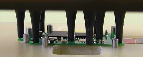 Closeup of the test fixture making contact with a board