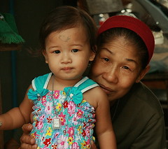 hiding behind the grandchild (the foreign photographer - ) Tags: grandma tattoo portraits thailand canal asia bangkok grandchild southeast inked bangkhen