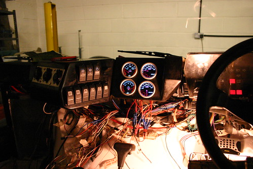 Dashboard wiring. On the left are three cigarette-lighter style power sockets.