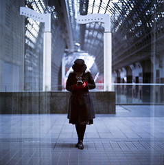 my reflection (yocca) Tags: camera reflection film me topf25 myself kyoto kodak 100v10f hasselblad  portra400nc 2009 500cm 15faves kyotostationbuilding 3030300 feb2009 me2009 reflectionlove