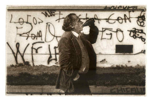 Charles Bukowski, patron saint of all broke-asses, doing his thing.