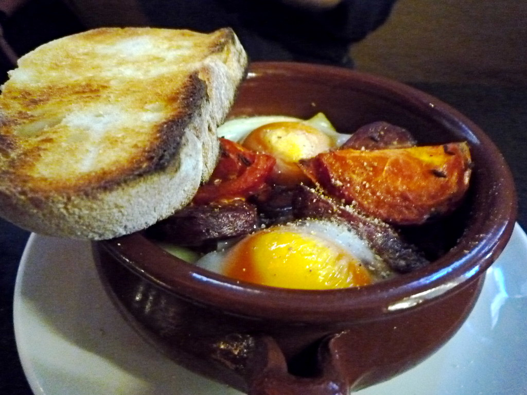 Claypot baked eggs with roast tomato, feta and chorizo